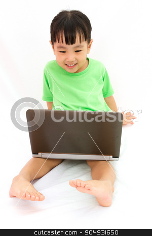Chinese little girl sitting on floor with laptop stock photo, Chinese little girl sitting on floor with laptop in plain isolated white background. by Tan Kian Khoon