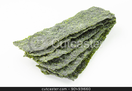 Fried seaweed on white background. stock photo, Close up the fried seaweed on white background. by Miss. PENCHAN  PUMILA