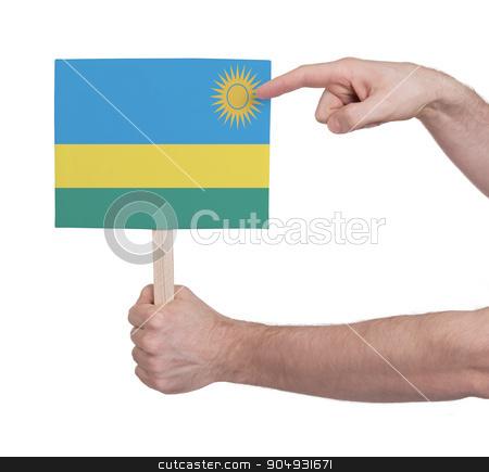 Hand holding small card - Flag of Rwanda stock photo, Hand holding small card, isolated on white - Flag of Rwanda by michaklootwijk