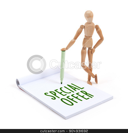 Wooden mannequin writing - Special offer stock photo, Wooden mannequin writing in a scrapbook - Special offer by michaklootwijk