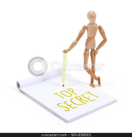 Wooden mannequin writing - Top secret stock photo, Wooden mannequin writing in a scrapbook - Top secret by michaklootwijk