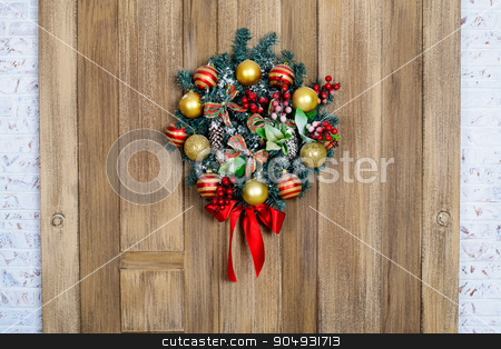 New Year's wreath on the door stock photo, beautiful and expressive Christmas wreath on the door by zakharovaleksey