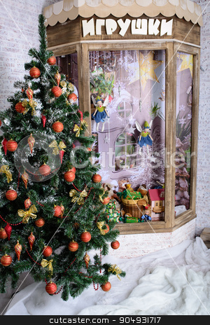 Christmas tree decoration near the window stock photo, Christmas tree decoration at the window of the toy store by zakharovaleksey