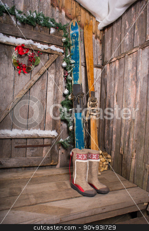 wooden skis standing near the porch stock photo, The old wooden Chalet with a decoration background skiing by zakharovaleksey
