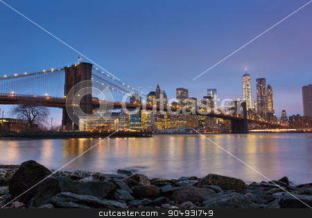Brooklyn bridge at dusk, New York City. stock photo, Brooklyn bridge and New York City Manhattan downtown skyline at dusk with skyscrapers illuminated over East River panorama.  by kasto