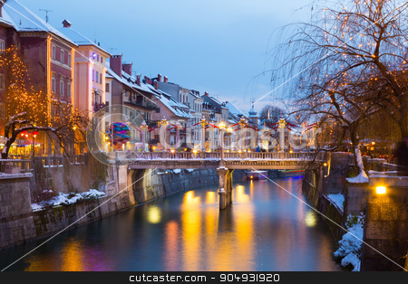 Ljubljana in Christmas time. Slovenia, Europe.  stock photo, View of lively river Ljubljanica bank with Cobblers' Bridge in old city center decorated with Christmas lights. Ljubljana, Slovenia, Europe. Shot at dusk. by kasto
