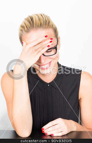 Relaxed business woman portrait stock photo, Relaxed cheerful business woman wearing black glasses blushing of embarrassment. by kasto