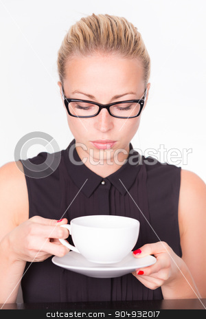 Business woman with cup of coffee. stock photo, Business woman wearing black glasses holding white cup of coffee in her hands. Coffee break. by kasto