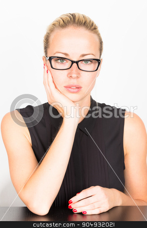 Business woman portrait stock photo, Business woman wearing black glasses sitting at the table resting her head on his hand. by kasto