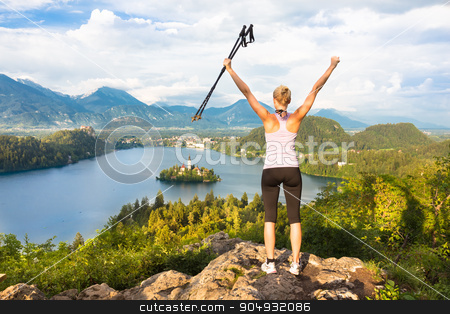 Tracking round Bled Lake in Julian Alps, Slovenia. stock photo, Made it! Young spoty active lady with hiking sticks and hands rised admiring beautiful nature around Bled Lake in Julian Alps, Slovenia.  by kasto
