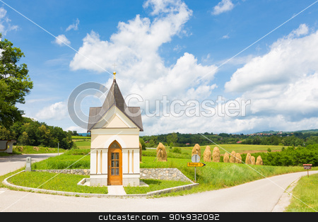 Traditional chapel in Slovenia, Europe. stock photo, Bela krajina, Slovenia. Traditional christian chapel and hay stacks on the field in the background. by kasto