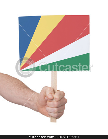 Hand holding small card - Flag of Seychelles stock photo, Hand holding small card, isolated on white - Flag of Seychelles by michaklootwijk