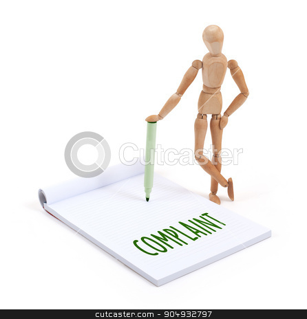 Wooden mannequin writing - Complaint stock photo, Wooden mannequin writing in a scrapbook - Complaint by michaklootwijk