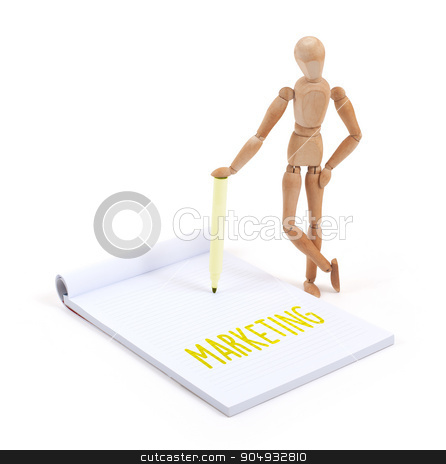 Wooden mannequin writing - Marketing stock photo, Wooden mannequin writing in a scrapbook - Marketing by michaklootwijk