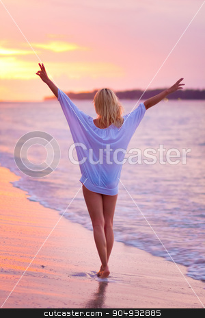 Lady on sandy tropical beach at sunset. stock photo, Beautiful blonde lady, arms rised in the sky, relaxing and enjoying vacations on the sandy tropical beach at sunset. by kasto
