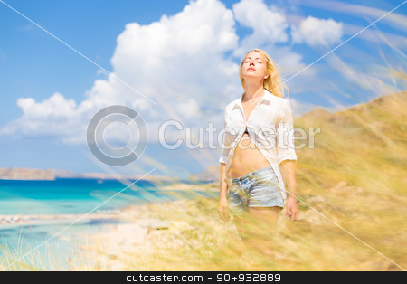 Free Happy Woman Enjoying Sun on Vacations. stock photo, Relaxed woman enjoying freedom and life an a beautiful sandy beach.  Young lady feeling free, relaxed and happy. Concept of freedom, happiness, enjoyment and well being.  Enjoying Sun on Vacations. by kasto