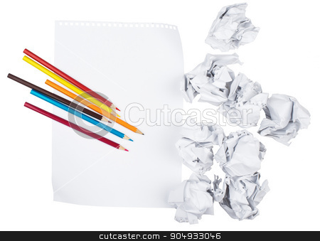 Paper with crayons and crumpled paper balls stock photo, Piece of paper with crayons and crumpled paper balls on isolated white background by cherezoff