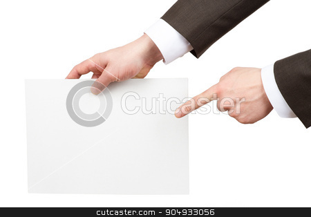 Businessman pointing at blank paper stock photo, Businessman pointing at blank paper on isolated white background by cherezoff
