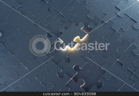 Grey puzzle background with empty space stock photo, Grey puzzle background with flying piece, close up view by cherezoff