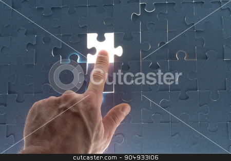 Missing jigsaw puzzle piece with light glow stock photo, Missing jigsaw puzzle piece with light glow, for completing the final puzzle piece by cherezoff