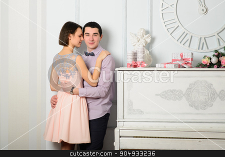 Couple in love near the piano stock photo, Couple in love near the piano. New Year, Christmas, holiday. Romantic evening by zakharovaleksey