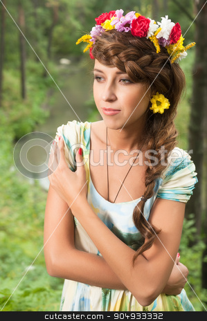 Young beautiful woman in wreath of flowers stock photo, Portrait of young brunette woman with flower wreath over nature background. forest Nymph by Aikon