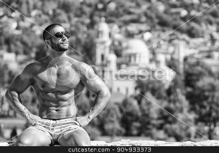 Bodybuilder Showing Off stock photo, Portrait Of A Physically Fit Man Showing His Well Trained Body Outdoors In Summer Time by Jasminko Ibrakovic
