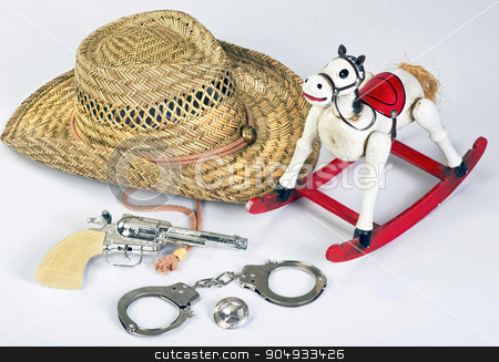 Cowboys Toys. stock photo, Old vintage childhood western cowboy toys. by WScott