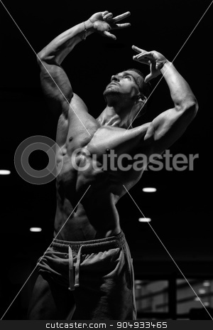 Strong Bodybuilding Man Looking Up stock photo, Athlete Muscular Brutal Bodybuilder Emotional Posing In A Dark Gym by Jasminko Ibrakovic