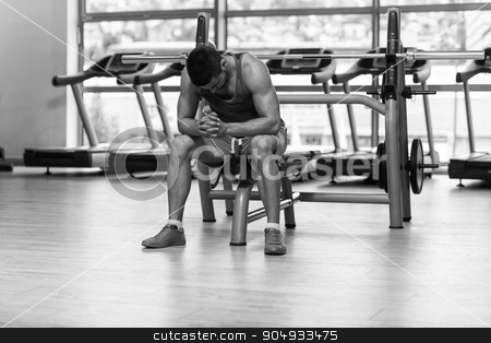 Attractive Young Man Resting Relaxed In Gym stock photo, Relaxing In Gym - Good Looking And Attractive Young Man With Muscular Body by Jasminko Ibrakovic