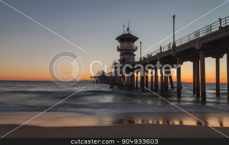 Under the Huntington Beach Pier stock photo, Under the Huntington Beach Pier in Huntington Beach, California, United States at sunset in the fall by Stephanie Starr