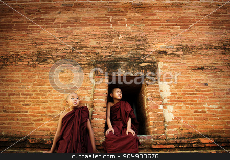 Buddhist novices stock photo, Young Buddhist novice monks at outside monastery, pagan, Myanmar. by szefei