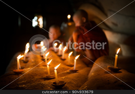 Buddhist novices with candle light inside temple stock photo, Little novice monks hand holding candlelight inside temple, Bagan, Myanmar. by szefei