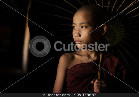 Buddhist novices holding umbrella stock photo, Portrait of young novice monks walking thru a Buddhist temple, Bagan, Myanmar. by szefei