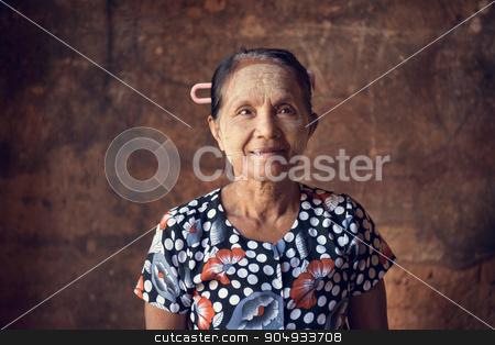 Old Burmese woman stock photo, Portrait of traditional Asian Burmese woman standing inside a temple, low light, Bagan, Myanmar by szefei