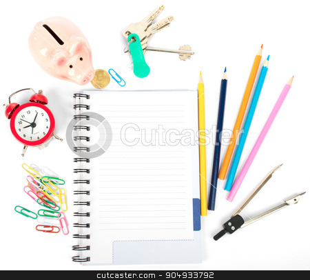 Open notebook with stationery and keys stock photo, Open notebook with stationery and keys isolated white background, closeup by cherezoff
