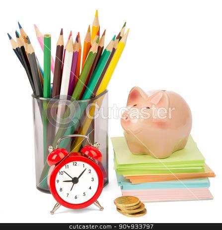 Alarm clock with piggy bank stock photo, Alarm clock with piggy bank and crayons isolated on white background by cherezoff