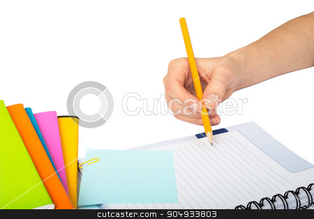 Females hand writing in notebook stock photo, Females hand writing within pen in notebook on isolated white background by cherezoff