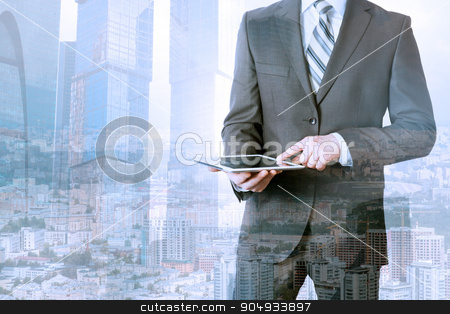 Businessman using tablet stock photo, Businessman using tablet on urban city background by cherezoff