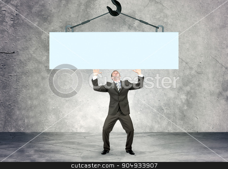 Businessman holding piece of wall stock photo, Businessman holding piece of blank wall, looking up by cherezoff
