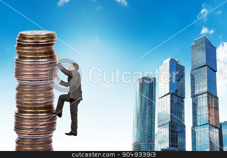 Businessman climbing up a huge stack of coins stock photo, Businessman climbing up a huge stack of gold coins with city background by cherezoff