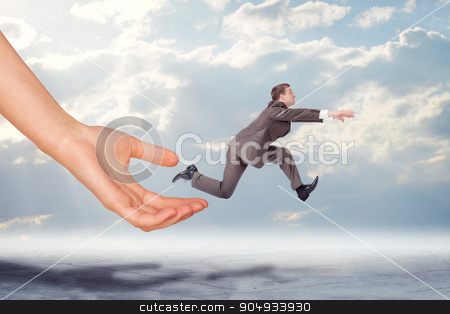 Hand catching businessman running forward stock photo, Hand catching businessman running forward with cityscape background by cherezoff