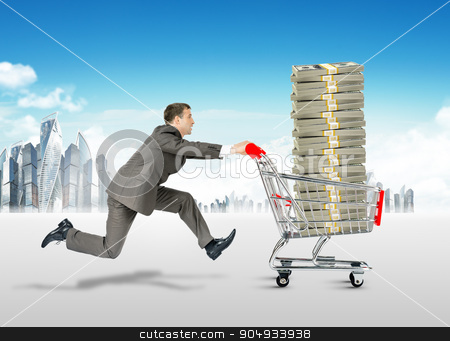 Running businessman with money in shopping cart stock photo, Running businessman with stack of money in shopping cart by cherezoff