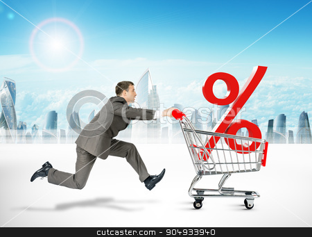 Running businessman with shopping cart stock photo, Running businessman with percent sign in shopping cart by cherezoff