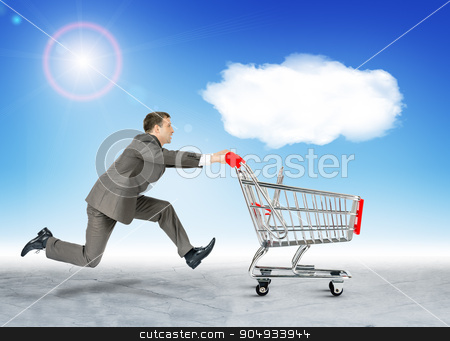 Running businessman with empty shopping cart stock photo, Running businessman with empty shopping cart and cloud by cherezoff