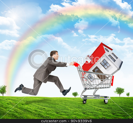 Running businessman with house in shopping cart stock photo, Running businessman with house in shopping cart nad rainbow by cherezoff