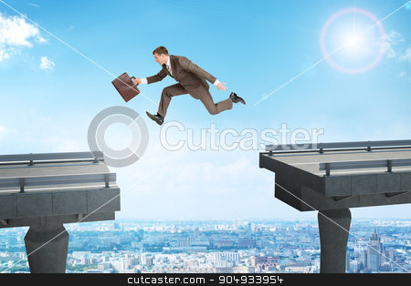 Image of young businessman jumping over gap stock photo, Image of young businessman with suitcase jumping over gap by cherezoff