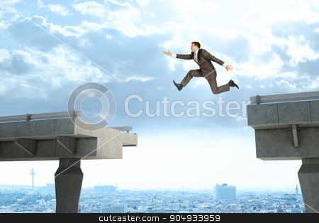 Image of young businessman jumping over gap stock photo, Image of young businessman jumping over gap of broken bridge by cherezoff