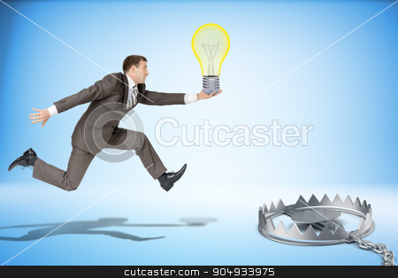 Businessman running forward  stock photo, Businessman with bulb running forward to beartrap by cherezoff