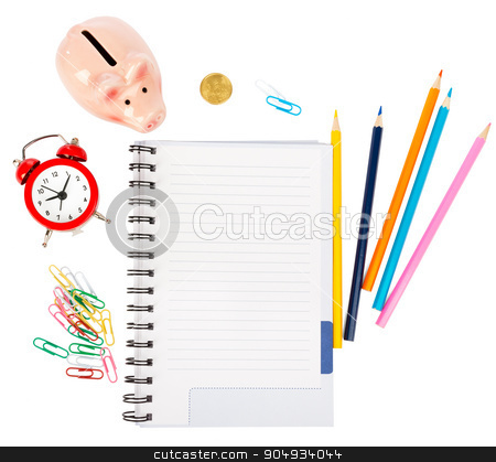 Open notebook with stationery and piggy bank stock photo, Open notebook with stationery and piggy bank isolated white background, closeup by cherezoff
